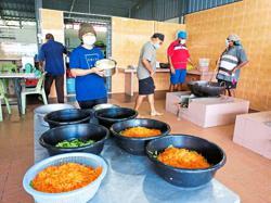 Volunteers prepare food at gurdwara kitchen for some 700 needy people