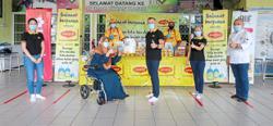 Brand distributes bubur lambuk and food packs to frontliners and underprivileged