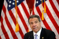 New York 'over the mountain' as new COVID cases fall to pre-crisis levels - governor