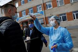 Russia reports record daily rise in new coronavirus deaths