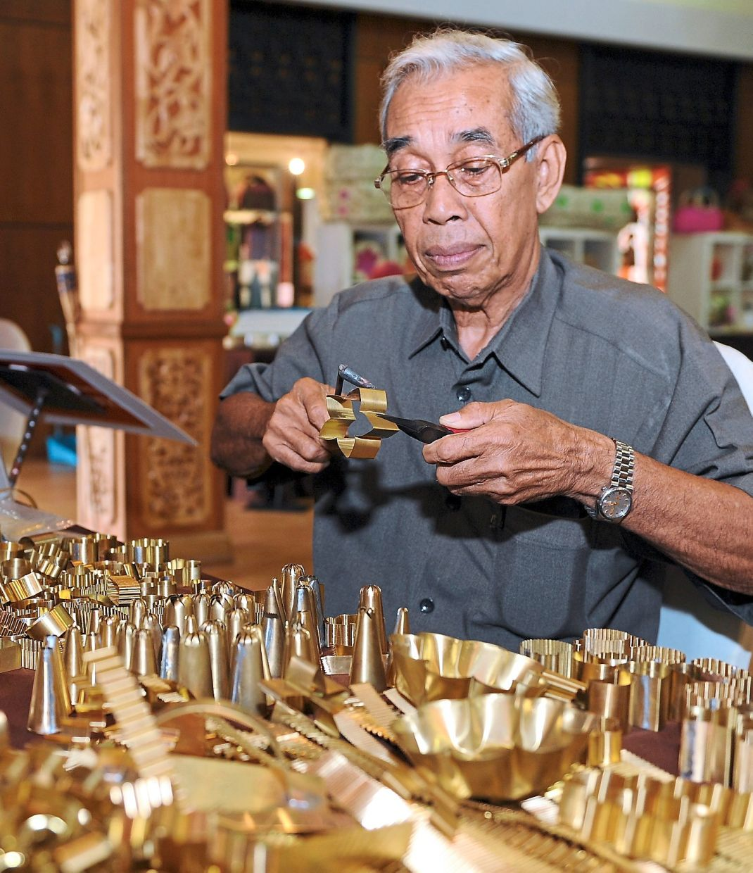 All Mohd Yusof needs is 10 minutes to whip up a simple biscuit mould or cookie cutter. Photo: Bernama