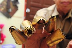 New normal demand for craftsman Tok Wans traditional Raya biscuit moulds