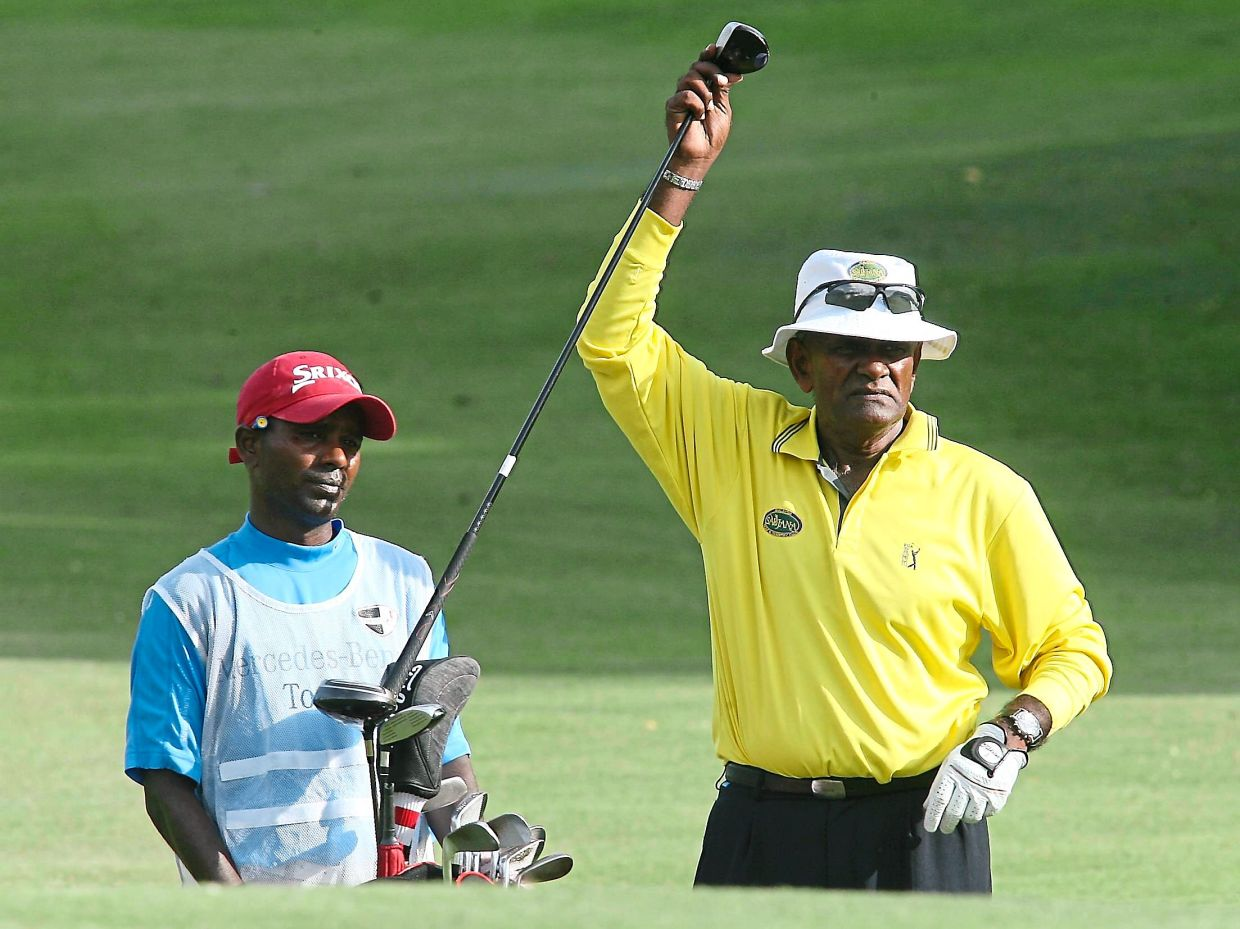 Nellan, at 62, with his caddie in the Mercedes-Benz Masters Malaysia.