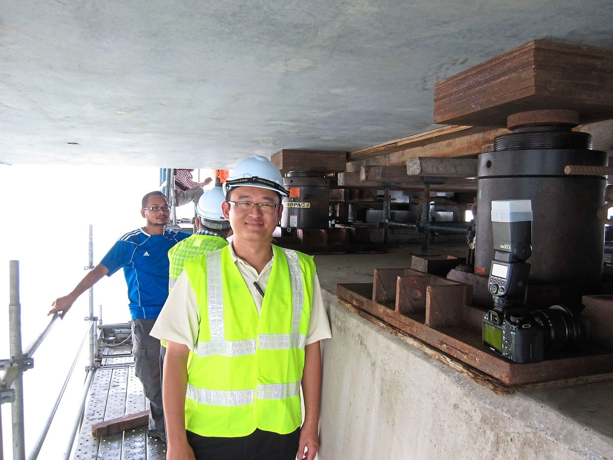 Dr Lee Jiang Jun is one of the Malaysian Rubber Board's senior scientists involved in creating an earthquake isolator used around the world.Here he's on site at the Second Penang Bridge during the installation of the isolators.