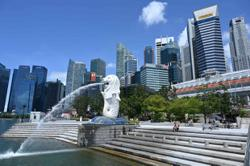Singapore unveils more virus stimulus, now worth 20% of GDP