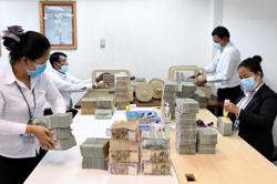 Acleda Bank celebrates successful entry at Cambodia's Stock Exchange