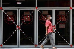 Singapore warns of worst economic contraction since independence