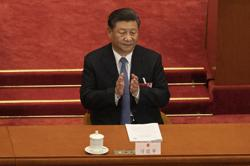 Xi stresses strengthening national defence, armed forces