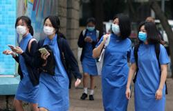 Hong Kong high school students go back to class