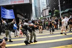 180 arrested in Hong Kong as riot police guard LegCo debating anthem bill