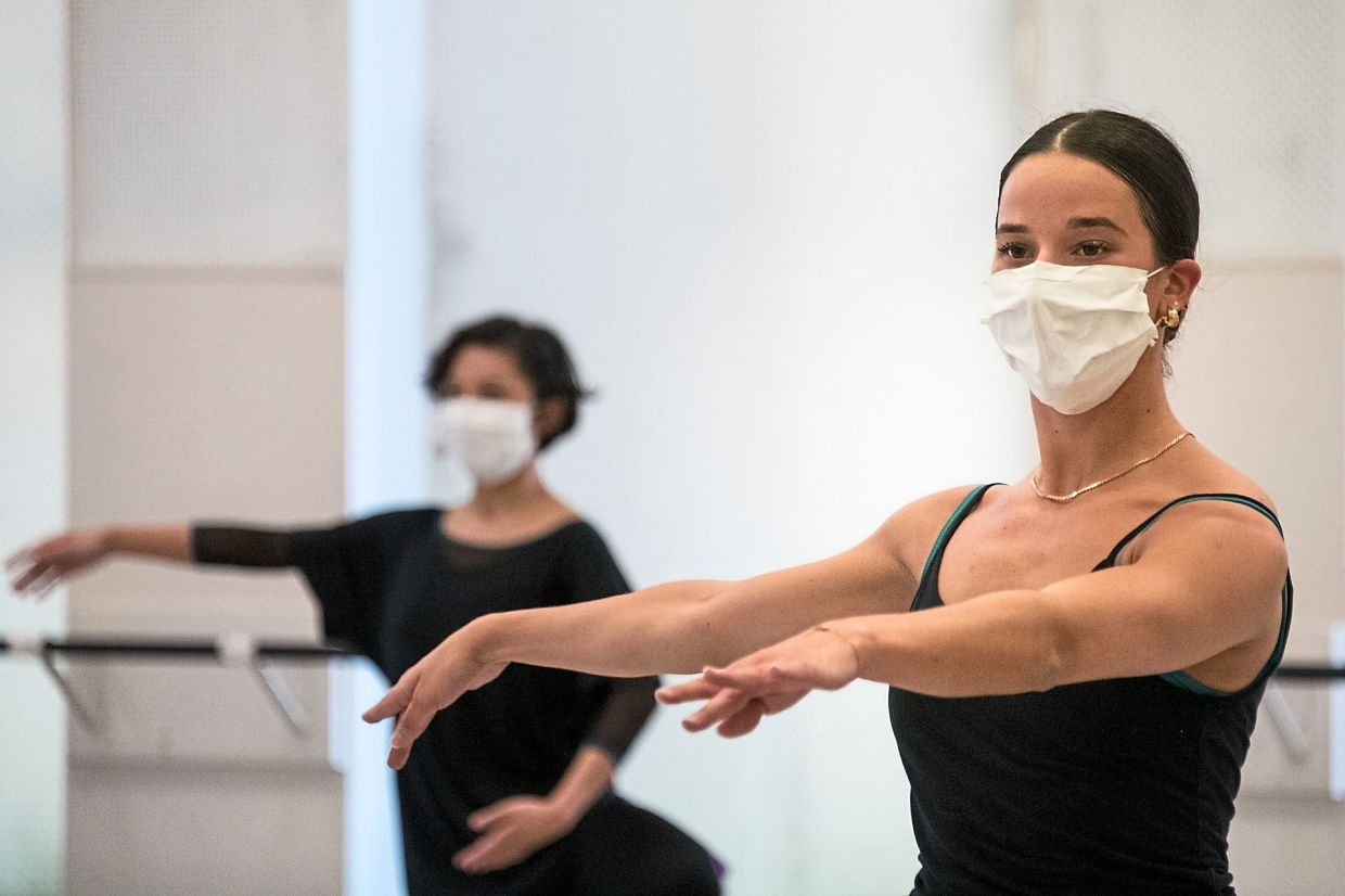 In virus-hit eastern France, masked dancers get back to work