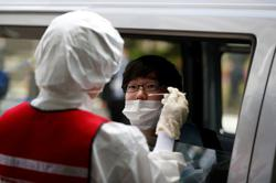 As Japan reopens, coronavirus testing slowed by bureaucracy and staff shortages