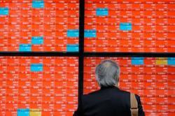 Asian markets cheered by reopening moves, Hong Kong limits losses