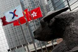 China stocks slip as investors await policy cues, HK signals