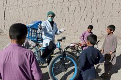 Afghan cyclist does 'door-to-door' campaign to curb virus