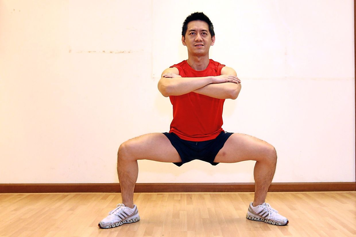 Wide-stance or duck squats may look easy, but squeezing and holding your muscles to stay in this position for 15-30 seconds like in this filepic, is when the effects really kick in.
