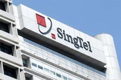 Singtel cuts expected dividend on lower profit