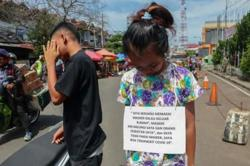 Indonesia rolls out public shaming for coronavirus violators