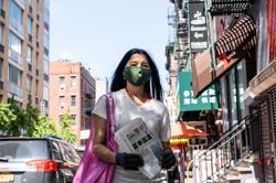 U.S. Asians, harassed over coronavirus, push back on streets, social media