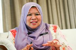 Rina Harun rubbishes rumours she quit Cabinet post