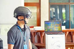 Smart helmets help scan temperature at mosques