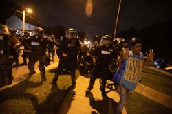 Officer charged with murder of black American, as protests spread