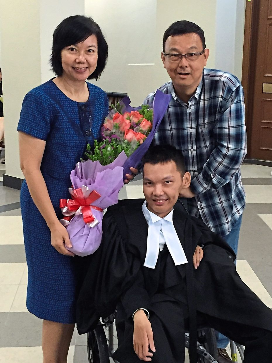 A file photo of Low with his parents after he was called to the Malaysian Bar in September 2016. Photo: Lee Yung Sen