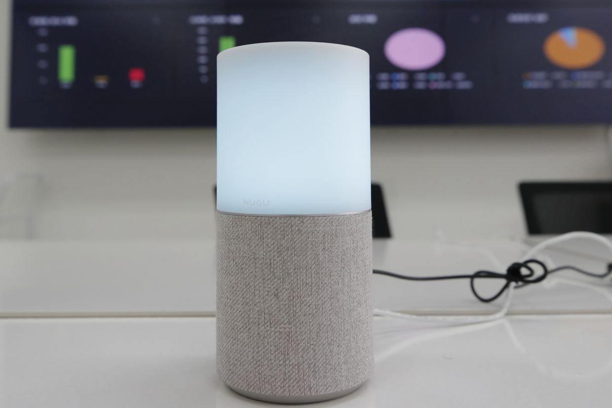 SK Telecom's AI speaker Nugu built with an artificial intelligence called 'Aria' and a lamp that turns blue when processing voice commands for news, music and Internet searches, is seen in Seoul, South Korea. The devices can also use quizzes to monitor the memory and cognitive functions of their elderly users, which would be potentially useful for advising treatments. — AP