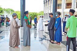 Bruneians return to mosques for prayers