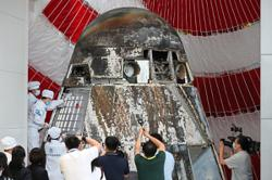 Space capsule opened for scientific research