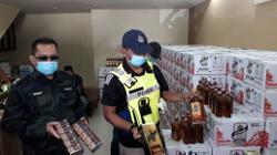 GOF seizes RM1.4mil worth of illicit liquor, cigarettes in Johor raid