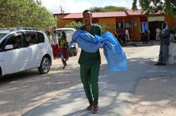 Somali minibus hits roadside bomb, six killed
