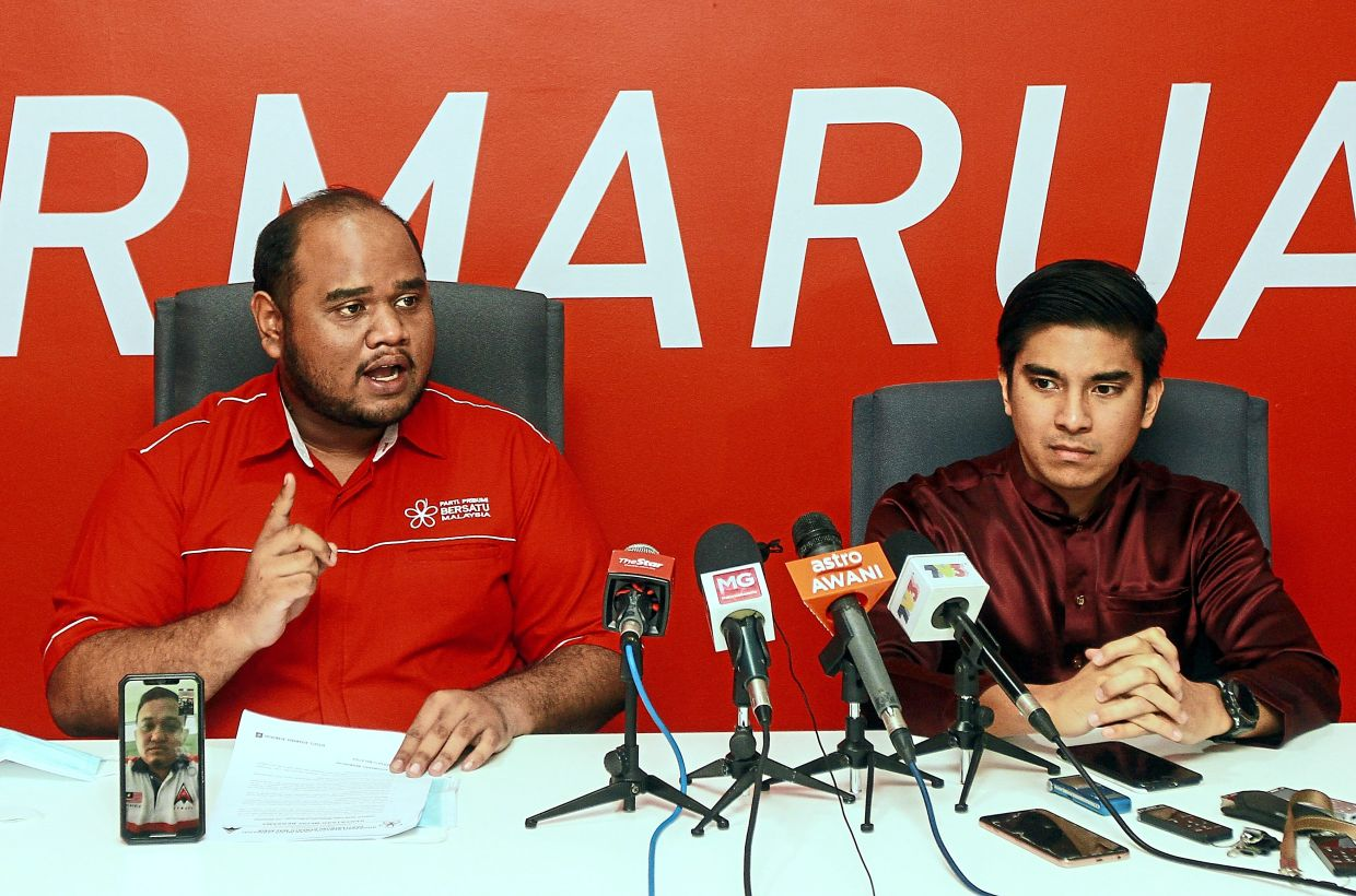 Saying his piece: Ulya speaking at a press conference in Putrajaya as Syed Saddiq looks on.