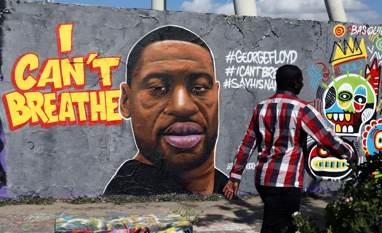 In Germany, a mural depicting Floyd has appeared on a part of the former Berlin Wall in Mauer Park. It was drawn by Berlin street artist Eme Freethinker. Outcry over the killing of Floyd has gone international, with people taking to the streets Berlin and London to show solidarity with US protesters. Photo: Reuters