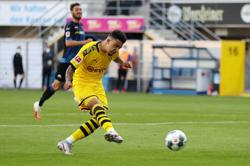 Sancho hat-trick keeps Dortmund in title hunt