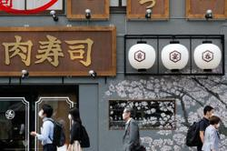 Japan considering re-opening door to some foreigners - media