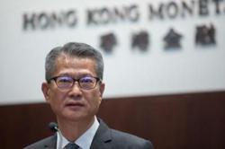 Hong Kong Finance Secretary says no plans to change US dollar peg