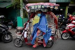 Philippines capital comes back to life although virus threat lingers