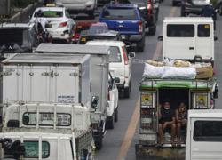 Manila choked by traffic as Philippine capital reopens despite jump in virus cases