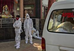 Relatives queue to cremate coronavirus dead in India's capital