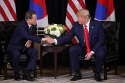 South Korea's Moon tells Trump he would accept invitation to G7 summit