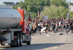 Minnesota trucker who drove through protesters was 'frustrated,' governor says