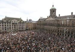 Amsterdam anti-racism rally criticised for lack of social distancing