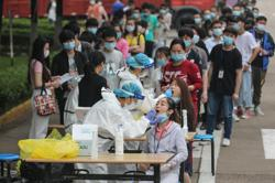 No new virus sufferers, 300 asymptomatic, after Wuhan-wide tests