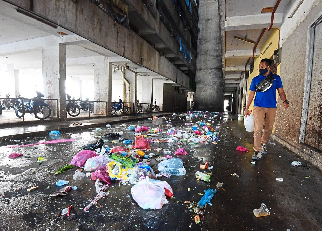 The common area littered with bags of rubbish at the Teluk Indah flats. — Photos: MUSTAFA AHMAD/The Star