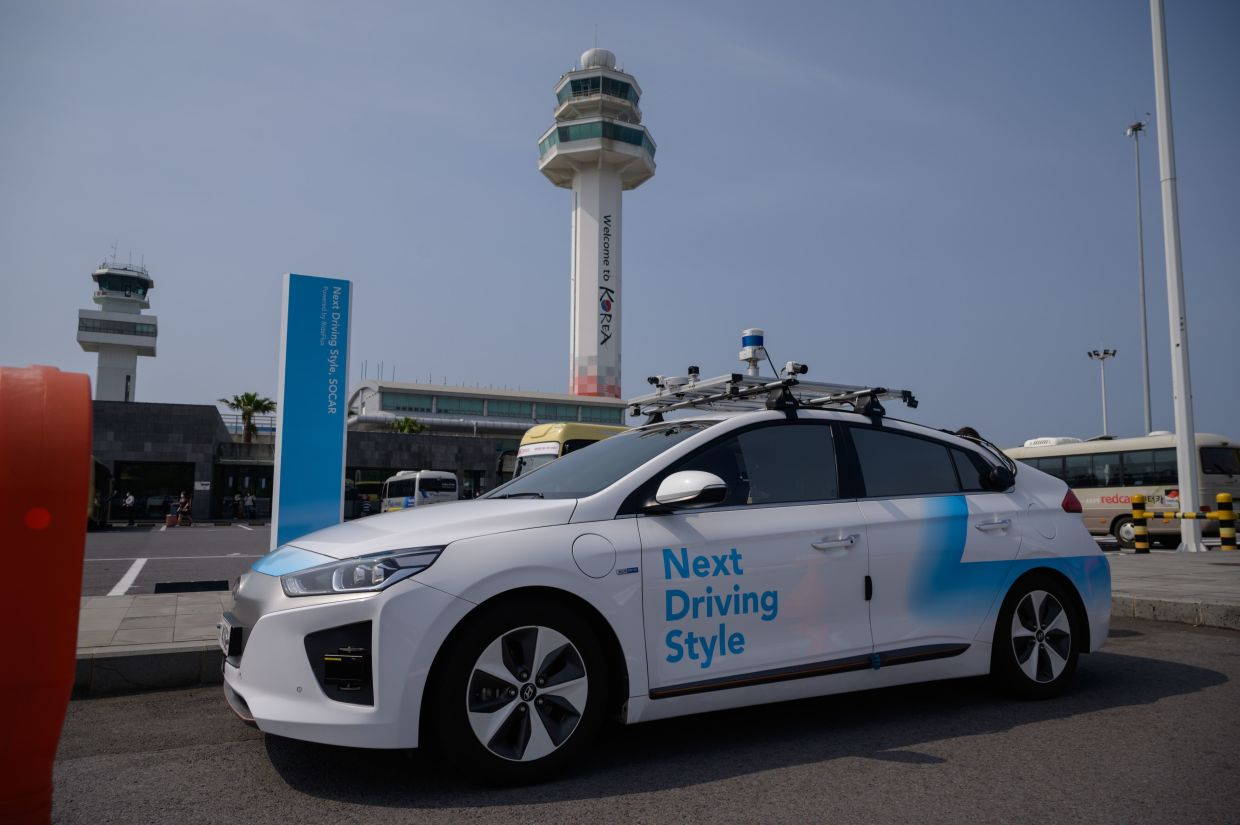 The startup's modified Hyundai Ioniq, festooned with cameras and proximity sensors, is the first autonomous vehicle to go into regular service on public roads in the country. For two weeks it has been shuttling customers from the airport on the tourist island of Jeju to rental company SoCar's service centre.