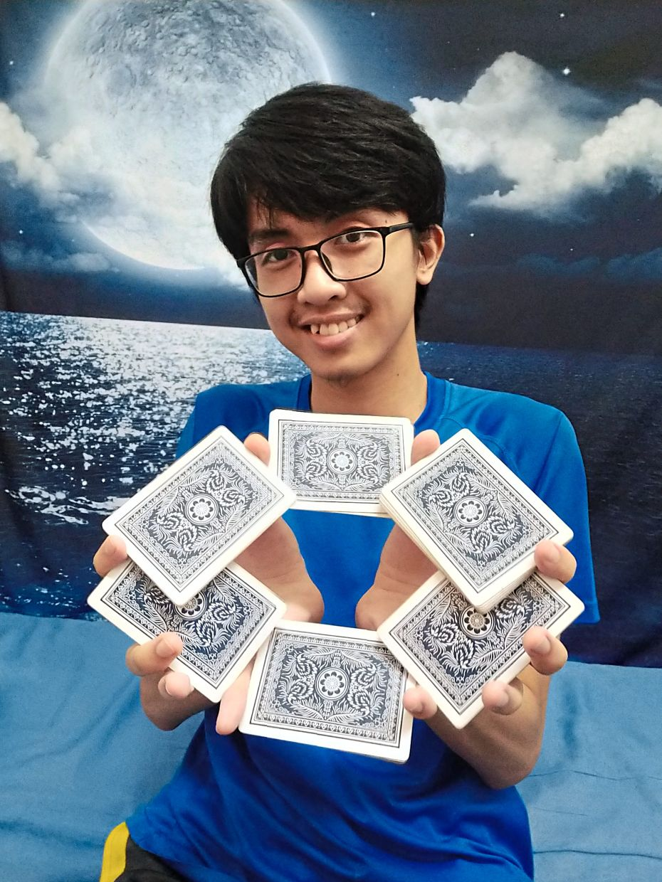 Hanif steps up on his card skills and has uploaded many card trick videos on YouTube and Instagram. Photo: Mohd Hanif Mohd Jame