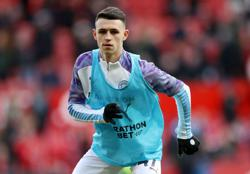 Man City's Foden breaks distancing rules to play at beach