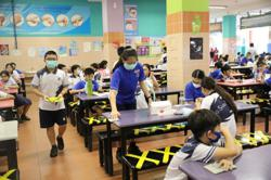 Pupils adapt to new normal of safe distancing as Singapore schools reopen