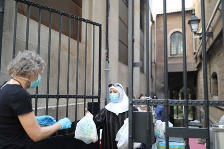 Queues for Spain's food banks swell as coronavirus cases dwindle